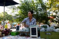 Megan Neubauer of Pure Land Organic sold kale and other produce at the McKinney Farmers Market in May 2017.(Anja Schlein/Special Contributor)