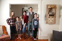 "<p>The Ettiene family in their <span style=""font-size: 1em; background-color: transparent;"">new home of 1,400 square feet in McKinney.</span></p>(Rose Baca/Staff Photographer)"