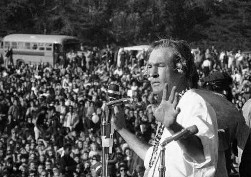 "Timothy Leary addresses a crowd of hippies at the ""Human Be-In"" that he helped organize in Golden Gate Park in San Francisco on Jan. 14, 1967.  (File Photo/The Associated Press)"