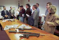 "In January 1999, FBI agent Ted Jackson (far left) showed reporters the weapons and pipe bombs confiscated after a shootout with a suspected bank robber in Columbus, Ohio. The FBI was investigating Peter Langan, known now as Donna Langan, arrested in Columbus, and Richard Lee Guthrie, arrested in Cincinnati, as the ""Midwestern Bank Bandits,"" two bank robbers who taunted federal authorities in a string of robberies throughout the Midwest.(File Photo/The Associated Press)"