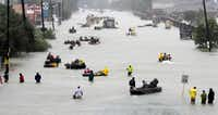 Rescue boats float on a flooded street as people are evacuated from rising floodwaters brought on by Hurricane Harvey on Aug. 28 in Houston.(David J. Phillip/The Associated Press)