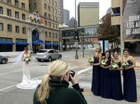 "<p>""Beauty is pain,"" quipped bride-to-be Tori Mellinger (left) tongue-in-cheek as she was getting outdoor portraits taken with her bridal party (from left) Lindsey Miller, Jenna Mellinger, Erin Mellinger and Stephanie Plugge. Photographer Elizabeth Evans, of Eliza Kennard Photography, was snapping their photos on a 28-degree afternoon (in a wind chill that felt like 16) before Tori Mellinger's nuptials to Andrew Plugge in downtown Dallas on Sunday.</p>(Michael Hamtil/Staff Photographer)"