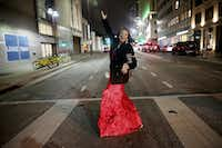 Candace Perry of Addison poses spontaneously while walking to a New Year's Eve party in downtown Dallas on Sunday in freezing weather.(Andy Jacobsohn/Staff Photographer)