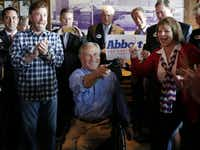 Greg Abbott campaigned with Chuck Norris (left) in Dallas at Sonny Bryan's Smokehouse on the final day of the campaign in November 2014.(David Woo/Staff Photographer)