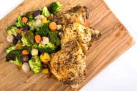 Oven baked chicken thighs with roasted carrots and broccoli(Ashley Landis/Staff Photographer)