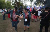 Erwin K. (left)  danced with his mother Carmen at Texas Latino Pride in October at Reverchon Park in Dallas.(Maria R.Olivas)