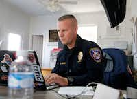 Fire Chief Robert Jones works from his laptop at the McLendon-Chisholm Volunteer Fire Department in McLendon-Chisholm, Texas. The Rockwall County town is without a fire services contract, and the department is using its own reserve funds.(Vernon Bryant/Staff Photographer)