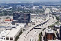 Dallas North Tollway splits Legacy West (left) and Shops of Legacy (right) in Plano.(Vernon Bryant/Staff Photographer)