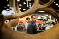 Ryan Plett looks at taxidermy work during the Dallas Safari Club annual convention and sporting expo at the Kay Bailey Hutchison Convention Center in Dallas on Thursday, Jan. 4, 2018.(Rose Baca/Staff Photographer)