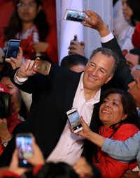 Jose Antonio Meade posed for selfies with supporters as he arrived for an event celebrating his registration as a candidate for the presidential nomination of the ruling Institutional Revolutionary Party in Mexico City on Dec. 3, 2017. Although not a party member, Meade got the support of most of the party's leaders at an event in which he registered, pretty much unopposed, for the party's nomination for the July 1 elections.(Rebecca Blackwell/The Associated Press)