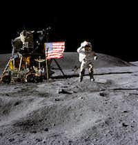In this April 1972 photo made available by NASA, John Young salutes the U.S. flag at the Descartes landing site on the moon during the first Apollo 16 extravehicular activity. NASA says the astronaut, who walked on the moon and later commanded the first space shuttle flight, died on Friday, Jan. 5, 2018. He was 87. <br>(Charles M. Duke Jr./The Associated Press)