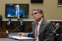 Energy Secretary Rick Perry listens to a statement by Energy and Commerce Committee Chairman Greg Walden, R-Ore., on TV monitor, during a hearing about the electrical grid, on Capitol Hill in Washington, Thursday, Oct. 12, 2017. (AP Photo/J. Scott Applewhite)(J. Scott Applewhite/AP)