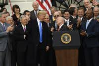 President Donald Trump, House Ways and Means  Committee Chairman Rep. Kevin Brady (at lectern), R-The Woodlands, and other lawmakers gathered last month on the South Lawn of the White House after passage of tax reform legislation.(Saul Loeb/Agence France-Presse)