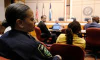 Interim Dallas County Sheriff Marian Brown (left) listens as Dallas County Commissioner John Wiley Price talks during a County Commissioners' meeting Tuesday to discuss ways to take better care of women in the Dallas County Jail. (David Woo/Staff Photographer)
