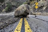 A large boulder sits in the middle of Bella Vista Drive in Montecito, Calif., following the rain storm, Tuesday, Jan. 9, 2018.(Michael Owen Baker/AP)