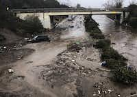 In a Santa Barbara County Fire Department photo, mud and debris fill the  Olive Mill Road underpass on U.S. 101 from flooding on Montecito Creek in Montecito, Calif., Jan. 9, 2018.(Mike Eliason/Santa Barbara County Fire Department)