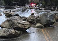In a Santa Barbara County Fire Department photo, rocks cover a road after a mudslide in Montecito, Calif., Jan. 9, 2018.(Mike Eliason/Santa Barbara County Fire Depart)