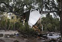 A structure is smashed against a tree along Hot Springs Road in Montecito, Calif. after getting hit by a flash flood and debris flow on Tuesday, Jan. 9, 2018. Several homes were swept away before dawn Tuesday when mud and debris roared into neighborhoods in Montecito from hillsides stripped of vegetation during a recent wildfire.(Daniel Dreifuss/AP)