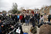 Mayor Douglas Athas (center) addressed the media in 2015 after a powerful tornado killed nine in Garland. (File 2015/Staff )