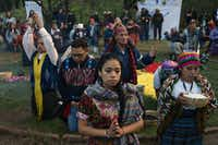 Mayan indigenous people celebrate a ceremony marking the 21st anniversary of the signing of the peace in Guatemala after 36 years of civil armed conflict (1960-1996), at the archaeological site of Kaminal Juyu in Guatemala City on December 29, 2017. (ORLANDO ESTRADA/AFP/Getty Images)