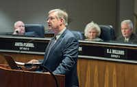 Garland Mayor Douglas Athas reads from his resignation letter before the start of the City Council meeting on Tuesday. In the background (from left) are Mayor Pro Tem David Gibbons and council members Anita Goebel and Jerry Nickerson.(Rex C Curry/Special Contributor)