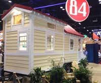 Homebuilders lined up to see a 154-square-foot tiny house at the International Builders Show in Orlando.(Steve Brown)