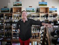Owner Thierry Plumettaz poses for a photograph at Le Caveau Vinotheque wine shop in Dallas.(Rose Baca/Staff Photographer)
