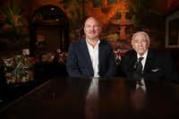 Mike Karns (left) is CEO of the Firebird Restaurant Group, which now owns El Fenix. He's shown at the downtown restaurant with Alfred Martinez, a member of the restaurant's founding family.(Andy Jacobsohn/Staff Photographer)