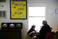 <p>Beverly Funk, a First United Methodist Church of Dallas volunteer, helps a student learn to read at J.J. Rhoads Learning Center.</p>(Nathan Hunsnger/The Dallas Morning News)