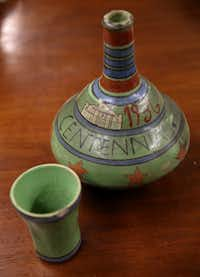 A hand-painted clay water jug souvenir from the Texas Centennial Exposition in 1936.(Rose Baca/Staff Photographer)