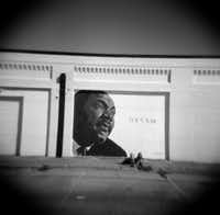 Dream, a mural depicting Martin Luther King Jr., is on the side of a building on Meadow Street at MLK Boulevard in South Dallas where Willie King was resting in the late morning sunlight waiting for a friend on a warm December day. A Holga photograph.(Guy Reynolds/Staff Photographer)