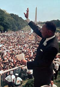 "In this Aug. 28, 1963, file photo, the Rev. Martin Luther King Jr. waves to the crowd at the Lincoln Memorial for his ""I Have a Dream"" speech during the March on Washington. The march was organized to support proposed civil rights legislation and end segregation.(File Photo/The Associated Press)"