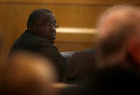 Antonio Cochran sits with his defense team during his capital murder trial this week.(Rose Baca/Staff Photographer)