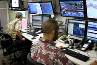 Hawaii Emergency Management Agency officials work at the department's command center in Honolulu in 2017. A false alert of a possible ballistic missile strike was issued on Saturday and wasn't corrected for 38 minutes.(Caleb Jones/AP)