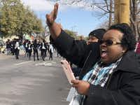 Anita Coleman cheers on her daughter Kimberlyn as she drives through in the parade. Kimberlyn Coleman was recognized for winning the 12th grade essay contest, put on by the Martin Luther King Jr. Community Center.(Dana Branham/Staff)