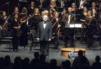 """<p><span style=""""font-size: 1em; background-color: transparent;"""">Maestro Anshel Brusilow pauses to acknowledge a standing ovation given him by the Richardson Symphony Orchestra and audience prior to the start of his final performance as music director/conductor on April 14, 2012, at the Charles Eisemann Center for the Performing Arts in Richardson.</span></p>(<p><span style=""""font-size: 1em; background-color: transparent;"""">Robert W. Hart/Special Contributor</span></p>/DMN file)"""