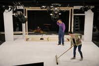 Jeff Mizener (back), assistant master carpenter and technical consultant, looks at the set as Madeleine Morris, stage manager, sweeps before a rehearsal  <i>Glengarry Glen Ross </i>at the Bath House Cultural Center in Dallas on December 4, 2017.  (Andy Jacobsohn/Staff Photographer)