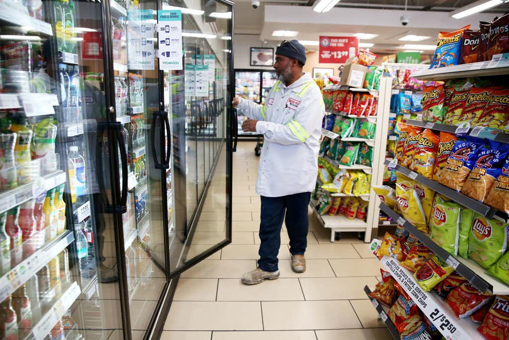 Cedrick Williams picks out a Gatorade at 7-Eleven in downtown Dallas.(Rose Baca<div><br></div>/Staff Photographer)