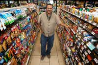 Franchise owner Bekele Tilahun poses for a photograph at his 7-Eleven in downtown Dallas.(Rose Baca/Staff Photographer)