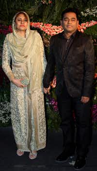 Indian film music composer and singer A.R. Rahman and his wife, Saira Banu.(Sujit Jaiswal/Agence France-Presse)