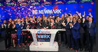 Emmitt Smith (front row, third from right) was on hand in New York last month when Newmark Group had its first public stock offering.(Nasdaq)
