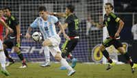 Argentina's Lionel Messi (10) is surrounded by the Mexico defense during the second half during the Mexico vs. Argentina soccer match held at AT&T Stadium in Arlington, Texas on Tuesday, September 8, 2015. (Louis DeLuca/The Dallas Morning News)(Louis DeLuca/Staff Photographer)