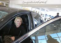 Christal Scott reacts to receiving a 2012 Honda Accord at Ewing Buick-GMC dealership in Plano on Jan. 16, 2018. The Watchdog wrote about  Christal, a single mother and waitress, who lost her car to another auto dealer's unfair repossession and had to go to court for resolution. She won her case, but the dealer ignored the verdict.<br>(Louis DeLuca/Staff Photographer)