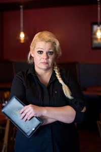 "Christal Scott, a 43-year-old single mother and waitress, posed for a portrait in December at Kay's Restaurant and Bar, where she works in Dallas.  After getting into a dispute over payments and having her car repossessed by 1and2 Automotive, Scott took the used car dealer to small claims court and was awarded $2,000.  ""I still feel like I lost,"" she said.(Jeffrey McWhorter/Special Contributor)"