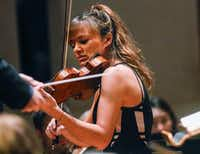 Nicola Benedetti was the guest violinist at the Dallas Symphony Orchestra concert Thursday.(Ron Baselice/Staff Photographer)