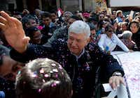 National Regeneration Movement, or MORENA, presidential hopeful Andres Manuel Lopez Obrador greets his supporters during a pre-campaign rally in Mexico City on Dec. 15, 2017. He leads polls on the race.(Eduardo Verdugo/The Associated Press)