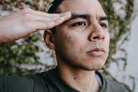 Christopher Llewn Ramirez performs in <i>Elliot, A Soldier's Fugue</i>, presented by WaterTower Theatre in Addison.(Evan Michael Woods)