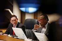 Dallas County Judge Clay Jenkins and Commissioner John Wiley Price listen to District 4 Commissioner Dr. Elba Garcia speak during a Dallas County Commissioners Court meeting.(Andy Jacobsohn/Staff Photographer)