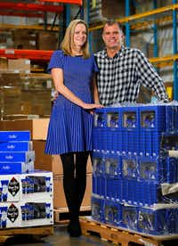 Curran Dandurand and her husband Jeff, co-founders with Emily Dalton (not pictured) of Jack Black men's personal care products are photographed in the Carrollton warehouse. (2016 File Photo/Tom Fox)