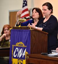 Carol Donovan, chairwoman of the Dallas County Democratic Party, (center), and Sarah Duncan, the Democratic Party lawyer (right), answers questions from concerned officials and candidates about a lawsuit filed by the Dallas Republican Party, during the Dallas County Democratic Party Executive Committee Meeting at the Communications Workers of America Union Hall in Dallas, Monday, Jan. 22, 2018. (Ben Torres/Special Contributor)